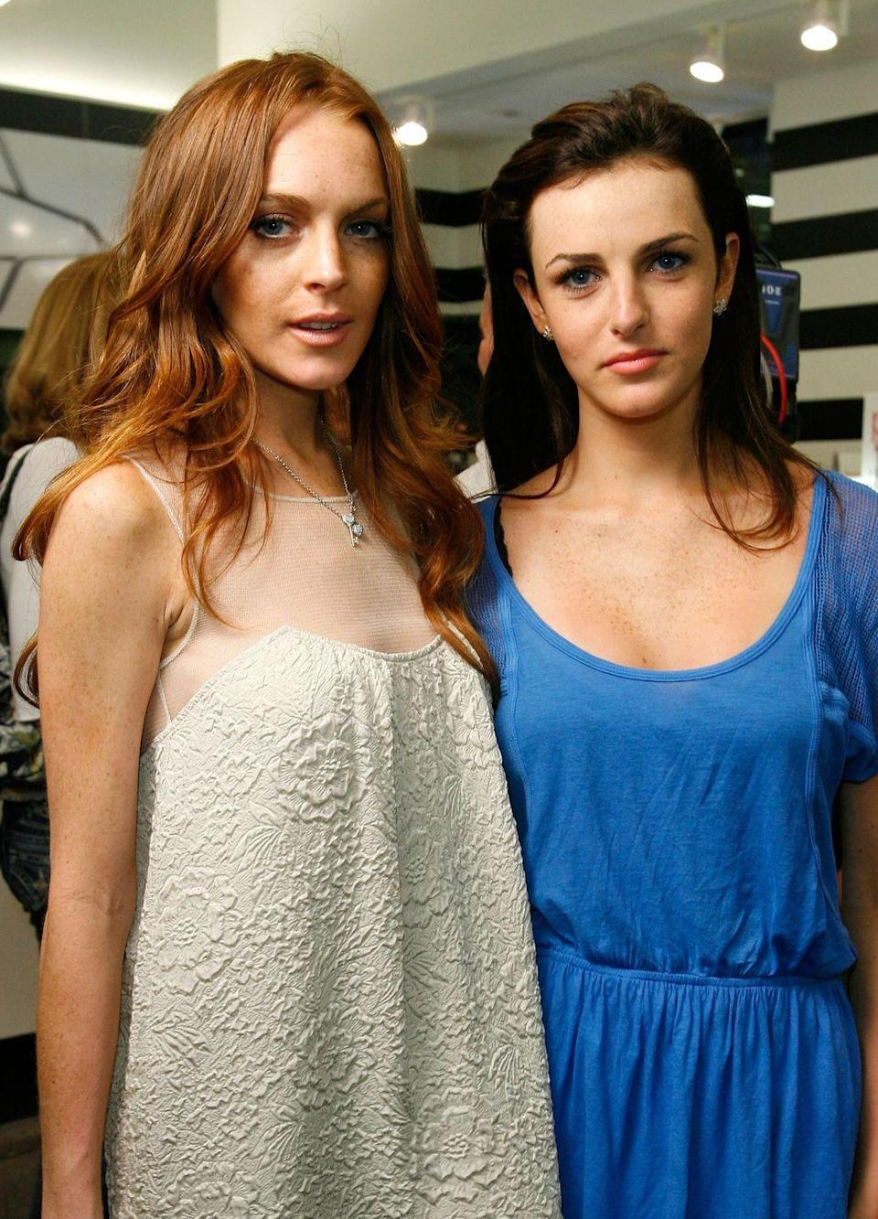 <p>Lindsay Lohan's famous red hair wasn't passed down to her sister, Ali, who has always been a dark brunette. But there's no denying their resemblance, despite Ali being 10 years younger. </p>