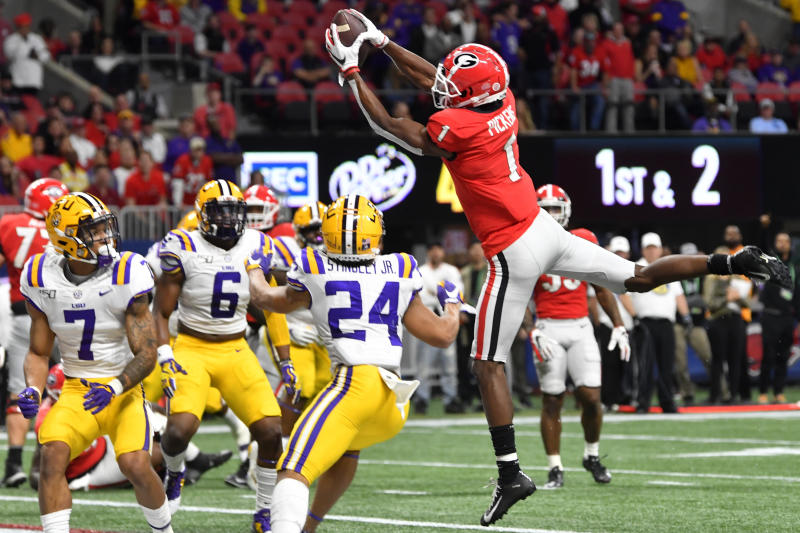 Georgia wide receiver George Pickens (1) makes a touchdpown catch against LSU during the second half of the Southeastern Conference championship NCAA college football game, Saturday, Dec. 7, 2019, in Atlanta. (AP Photo/John Amis)