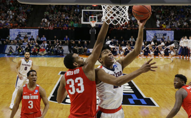 Gonzaga forward Rui Hachimura, center right, shoots around the defense of Ohio State forward Keita Bates-Diop (33) during the second half of a second-round game in the NCAA men's college basketball tournament Saturday, March 17, 2018, in Boise, Idaho. (AP Photo/Otto Kitsinger)