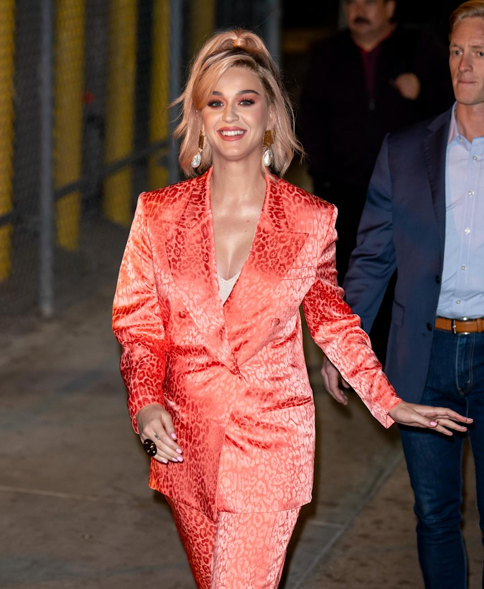 Suits are an underrated maternity must-have and Perry is rocking this leopard print number with ease. She wore this to Jimmy Kimmel live and even dyed her hair peach to match the suit's vibes. (Getty Images)