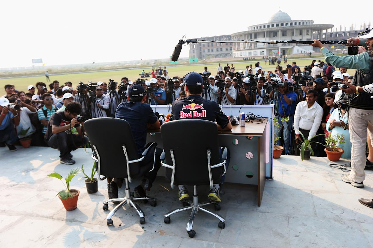 NOIDA, INDIA - OCTOBER 24:  Mark Webber of Australia and Red Bull Racing meets Indian cricketer Gautam Gambhir during previews for the Indian Formula One Grand Prix on October 24, 2012 in Noida, India.  (Photo by Mark Thompson/Getty Images)