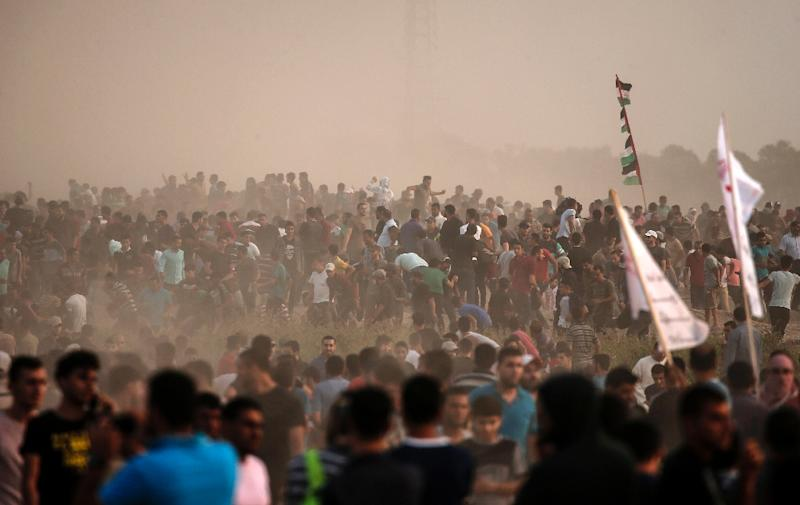 Palestinian protesters gather during a demonstration near the border with Israel, east of Gaza City (AFP Photo/MAHMUD HAMS)