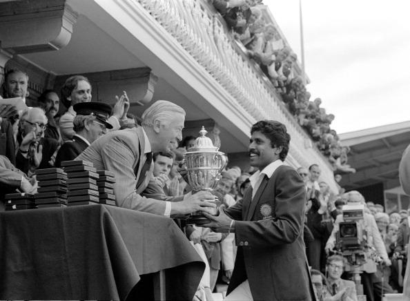 Cricket World Cup 1983 Final India v West Indies at Lord's Kapil Dev receives the Prudential World Cup from the Prudential Managing Director 63387_17 (Photo by Patrick Eagar/Patrick Eagar Collection via Getty Images)