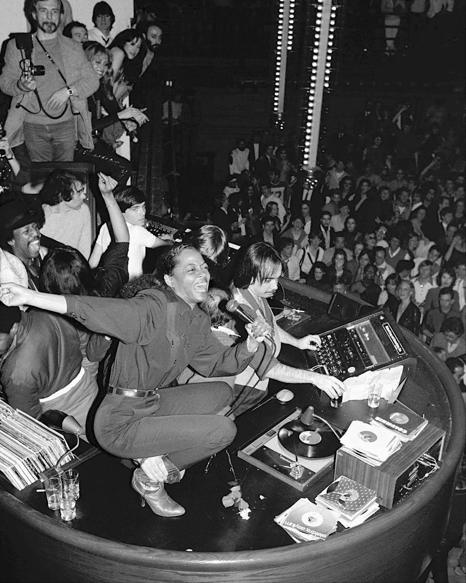"""<p>A frequent reveler at New York City's Studio 54, here the singer belts it out on the DJ booth in 1980. Diana Ross capitalized on the disco dance craze with a few albums, the first being <a href=""""https://www.mprnews.org/story/2016/06/10/diana-ross-went-disco-hit-number-one"""" rel=""""nofollow noopener"""" target=""""_blank"""" data-ylk=""""slk:Love Hangover"""" class=""""link rapid-noclick-resp""""><em>Love Hangover</em></a>, which she released in 1976.</p>"""