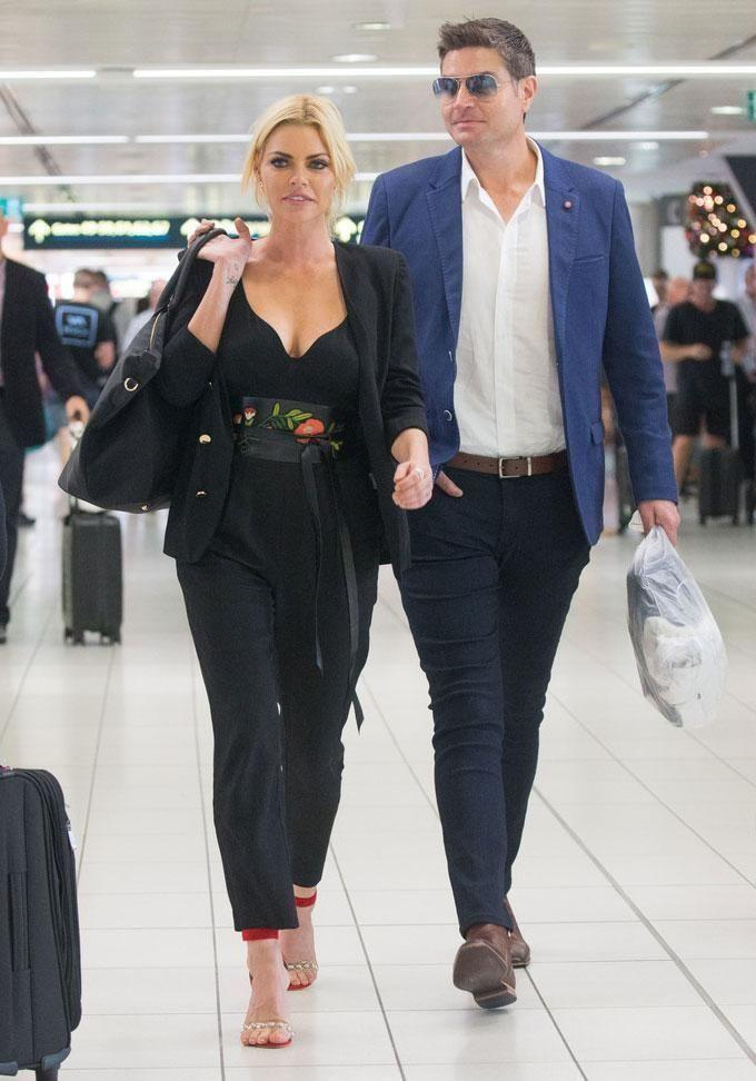 Sophie Monk and Stu Laundy hardly looked loved-up at Sydney Airport last month. Source: Media-Mode