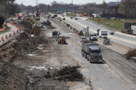FILE - In this April 20, 2020, file photo work continues on the Interstate Highway 75 project in Hazel Park, Mich. Looking beyond the $1.9 trillion COVID relief bill, President Joe Biden and lawmakers are laying the groundwork for another of his top legislative priorities — a long-sought boost to the nation's roads, bridges and other infrastructure that could meet GOP resistance to a hefty price tag. (AP Photo/Carlos Osorio, File)