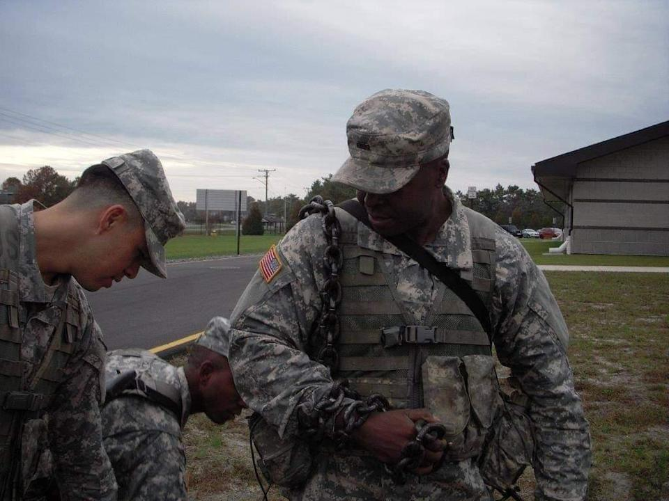 Maryland National Guard Sgt. Bruce Weaver wearing a chain as discipline after a minor infraction.