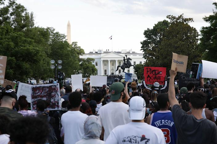 Demonstrators gather at Lafayette Park across from the White House, May 30, 2020. (Yasin Ozturk/Anadolu Agency via Getty Images)