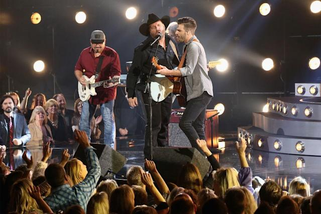 <p>Garth Brooks and Mitch Rossell perform onstage at the 51st annual CMA Awards at the Bridgestone Arena on November 8, 2017 in Nashville, Tennessee. (Photo by Terry Wyatt/FilmMagic) </p>