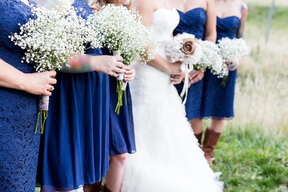 Is it reasonable to tell off your bridesmaid for holding her bump in the wedding pictures? [Photo: Getty]