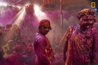 <p>Lath mar Holi is a local celebration of the Hindu festival of Holi. It takes place days before the actual Holi in the neighboring towns of Barsana and Nandgaon near Mathura in the state of Uttar Pradesh, where thousands of Hindus and tourists congregate, each year. (© Sampa Guha Majumdar/National Geographic Travel Photographer of the Year Contest) </p>