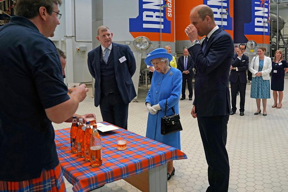 Britain's Prince William, Duke of Cambridge, (R) samples Irn-Bru as he and Britain's Queen Elizabeth II  visit AG Barr's factory in Cumbernauld, east of Glasgow, where the Irn-Bru drink is manufactured on June 28, 2021. - The Queen is in Scotland for Royal Week where she will be undertaking a range of engagements celebrating community, innovation and history. (Photo by Andrew Milligan / POOL / AFP) (Photo by ANDREW MILLIGAN/POOL/AFP via Getty Images)