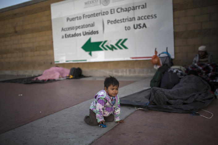 Steven Aguila, 2, from El Salvador, plays with a toy car at the Chaparral border crossing, in Tijuana, Mexico, Friday, Nov. 23, 2018. The mayor of Tijuana has declared a humanitarian crisis in his border city and says that he has asked the United Nations for aid to deal with the approximately 5,000 Central American migrants who have arrived in the city. (AP Photo/Rodrigo Abd)