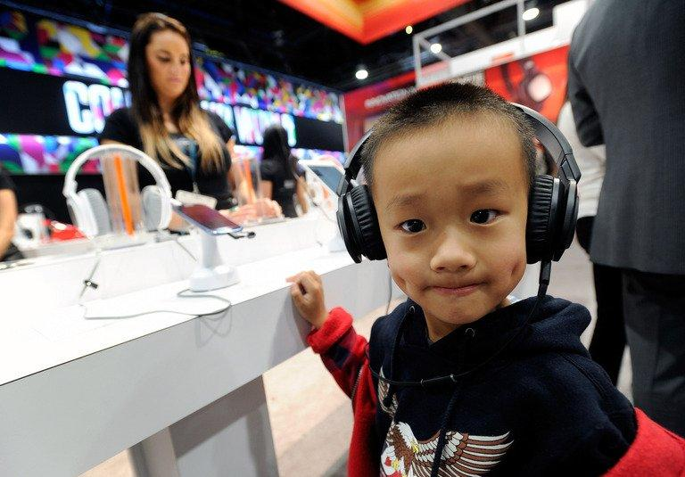 A young boy listens to music on a pair of headphones at the CES in Las Vegas on January 9, 2013. The technology industry displaying its wares at the massive Consumer Electronics Show this week included a variety of products and apps aimed at the youngest audiences, even those unable to walk