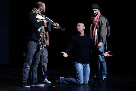 """Belgian playwright and actor Ismael Saidi performs in his play """"Jihad"""" at a theatre in Valenciennes"""