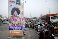 A banner for the campaign of presidential candidate Elisabeth Agbossaga is displayed along a road in the Stade-Kouhounou district in Cotonou, Benin March 4, 2016. The banner reads 'Women, I am your solution'. REUTERS/Akintunde Akinleye