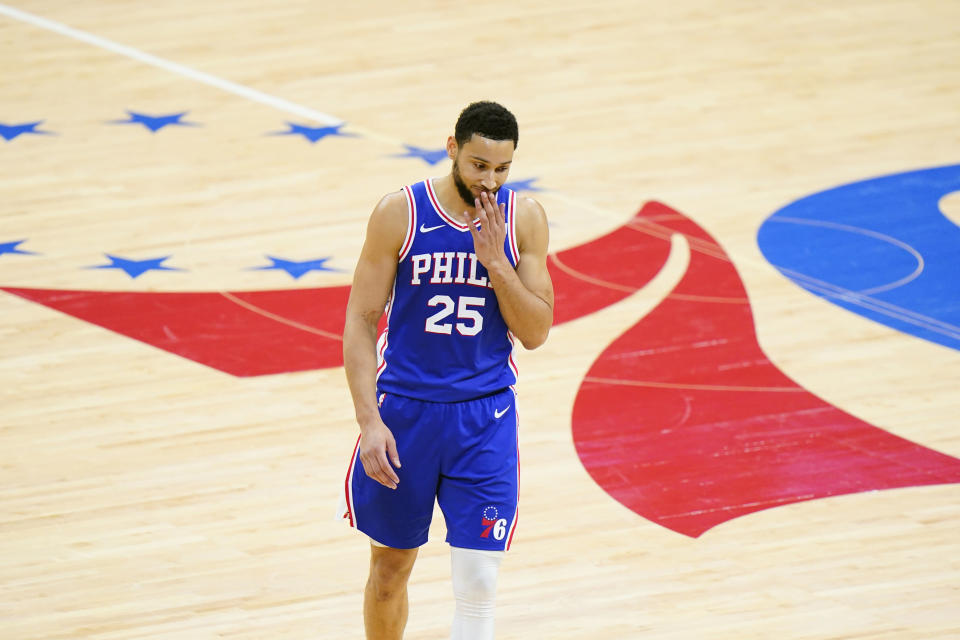 FILE - In this June 16, 2021 file photo, Philadelphia 76ers' Ben Simmons wipes his face during the second half of Game 5 in a second-round NBA basketball playoff series against the Atlanta Hawks in Philadelphia. Simmons will not report to the 76ers when they open training camp on Tuesday, Sept. 28, 2021. Team President Daryl Morey said there's still hope Simmons will return at some point. (AP Photo/Matt Slocum)