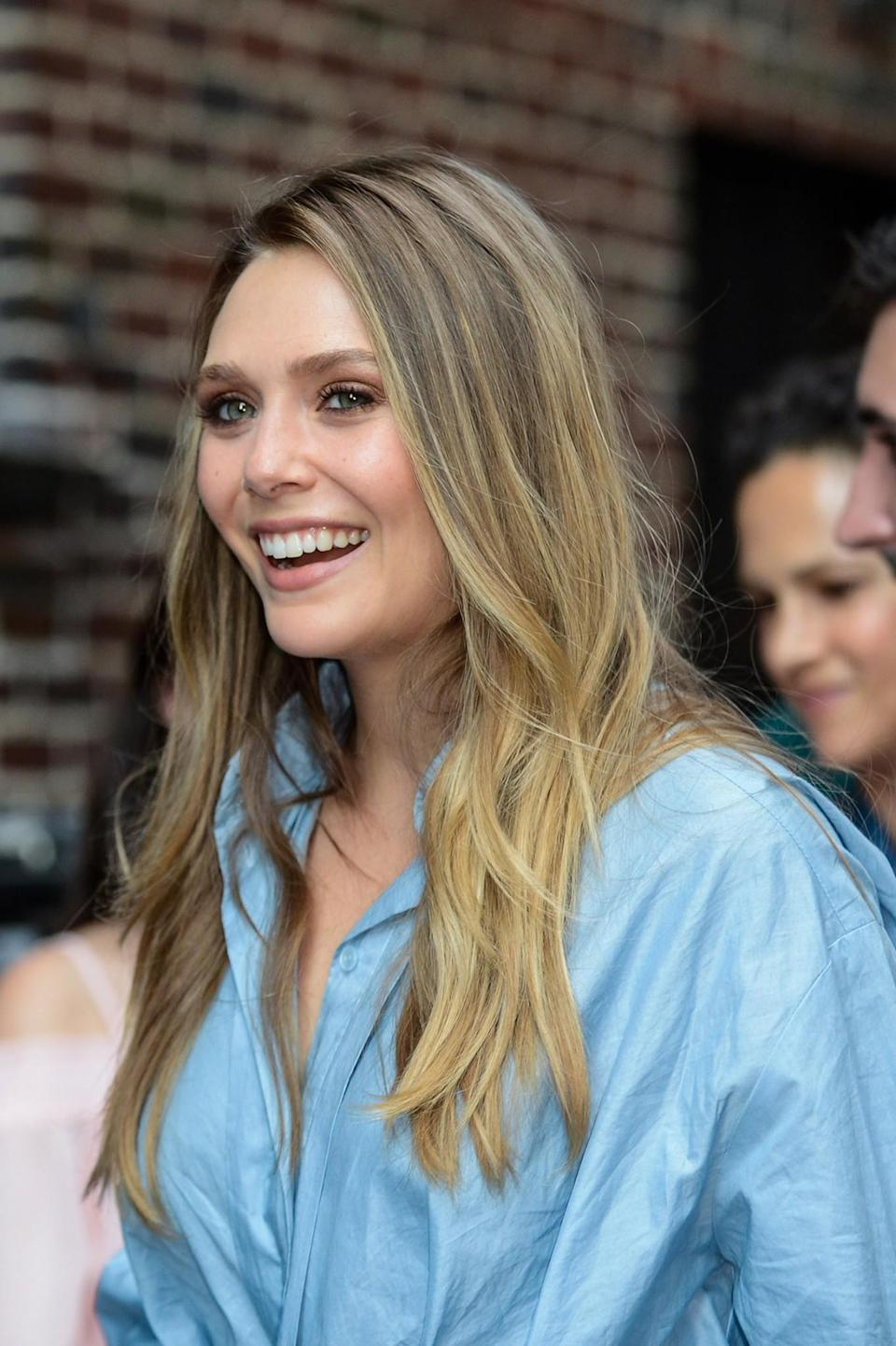 <p>Olsen made an appearance on <em>The Late Show With Stephen Colber</em> wearing beachy, blond waves and tawny eyeshadow that made her blue eyes pop. (Photo: Getty Images) </p>