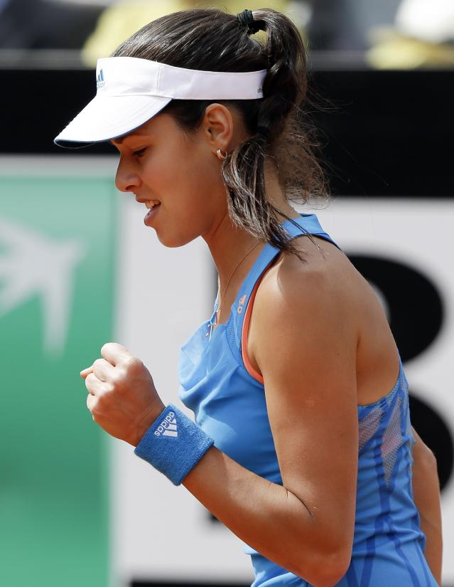 Ana Ivanovic of Serbia reacts during her women's singles match against Maria Sharapova of Russia at the Rome Masters tennis tournament