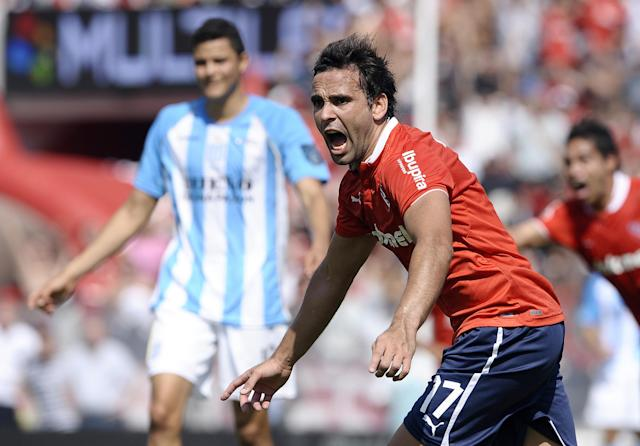 Independiente's forward Facundo Parra (R) celebrates after scoring against Racing Club, during their Argentina First Division football match, at the Libertadores de America stadium in Buenos Aires, on April 14, 2012. AFP PHOTO / Alejandro PAGNI (Photo credit should read ALEJANDRO PAGNI/AFP/Getty Images)