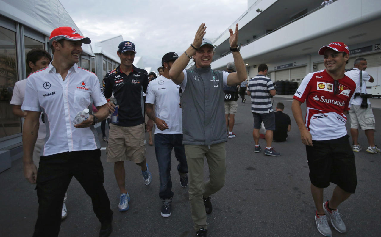 (L-R) McLaren Formula One driver Jenson Button of Britain, Red Bull Formula One driver Mark Webber of Australia, Mercedes Formula One driver Lewis Hamilton of Britain, Mercedes Formula One driver Nico Rosberg of Germany and Ferrari Formula One driver Felipe Massa of Brazil walk after the second practice session of the Japanese F1 Grand Prix at the Suzuka circuit October 11, 2013. REUTERS/Issei Kato (JAPAN - Tags: SPORT MOTORSPORT F1 TPX IMAGES OF THE DAY)