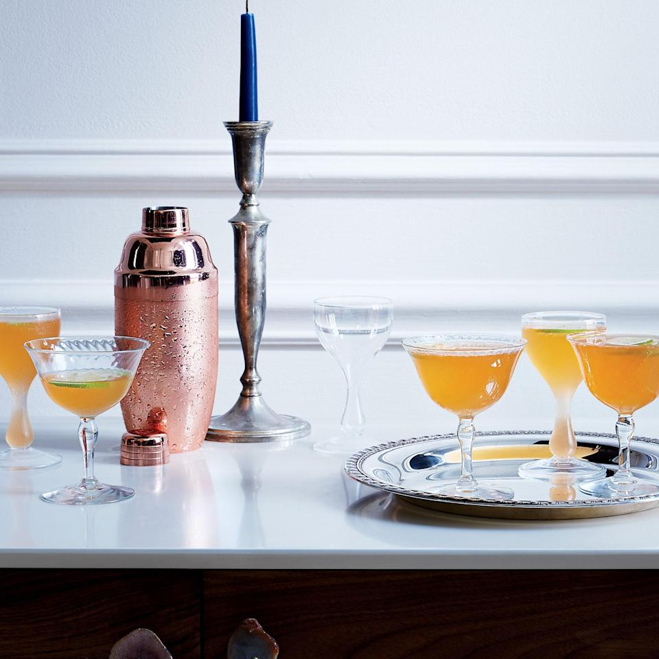 """Mark any special occasion with this lovely, fizzy drink, made with sparkling wine, gin, honey, fresh lime, and Aperol. <a href=""""https://www.epicurious.com/recipes/food/views/saint-florent-cocktail-51252660?mbid=synd_yahoo_rss"""" rel=""""nofollow noopener"""" target=""""_blank"""" data-ylk=""""slk:See recipe."""" class=""""link rapid-noclick-resp"""">See recipe.</a>"""