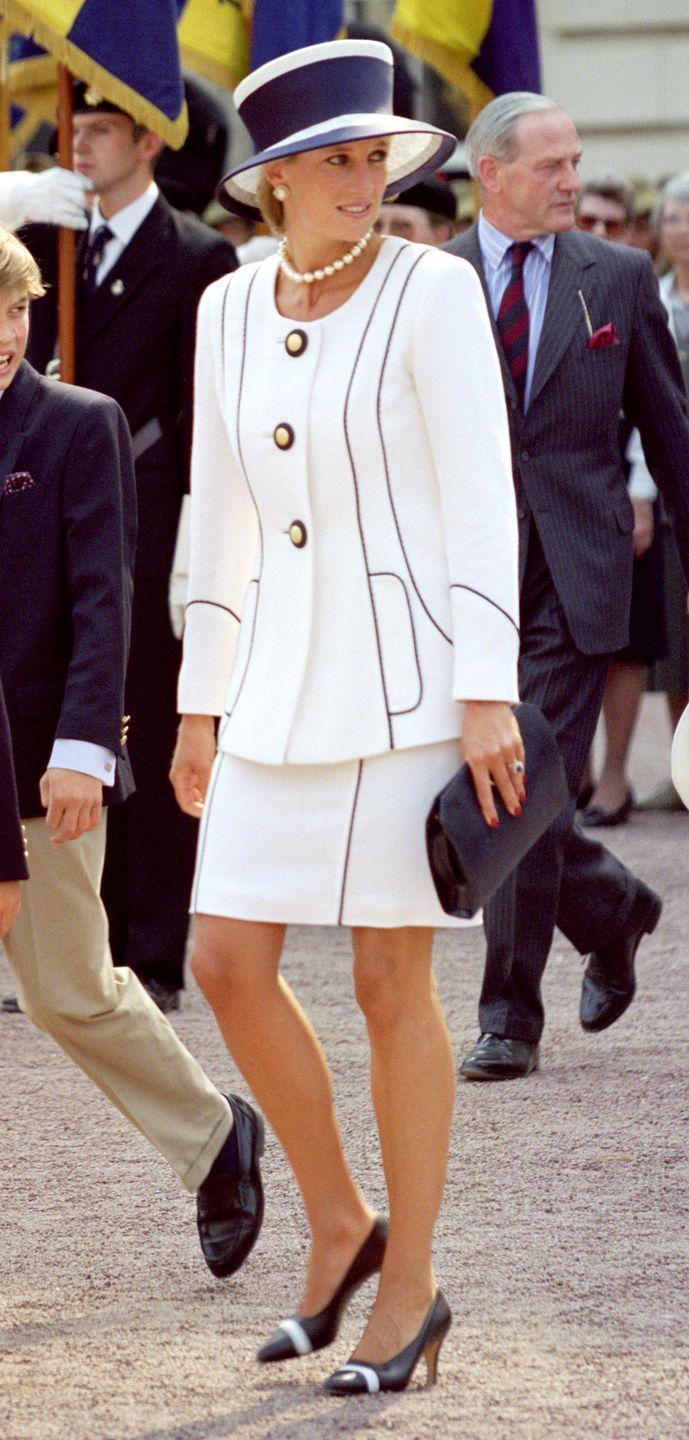 <p>In a white two-piece look with a pearl necklace and earrings in London.</p>