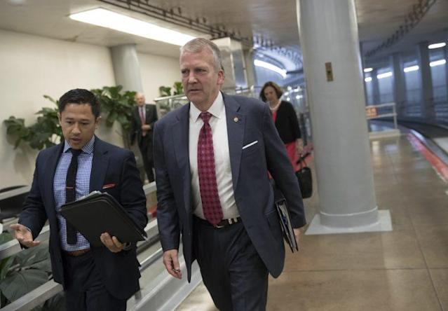 Sen. Dan Sullivan, R-Alaska, arrives at the Capitol for a meeting with Senate Majority Leader Mitch McConnell, R-Ky., who was announcing the release of the Republicans' initial health care bill on June 22. (AP Photo/J. Scott Applewhite)
