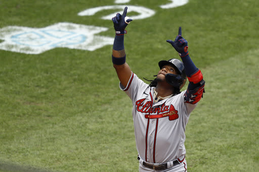 Atlanta Braves' Ronald Acuna Jr. reacts after hitting a two-run home run off Philadelphia Phillies relief pitcher Deolis Guerra during the fifth inning of the first baseball game in a doubleheader, Sunday, Aug. 9, 2020, in Philadelphia. (AP Photo/Matt Slocum)