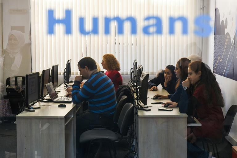 Humans In the Loop has trained a number of refugees to do work created by the growth of artificial intelligence An innovative Bulgarian companym, Humans In The Loop (HITL), is using new forms of work created by the growth of artificial intelligence to tackle the challenge of finding work for refugees -- even far beyond Bulgaria's borders. (AFP Photo/NIKOLAY DOYCHINOV)
