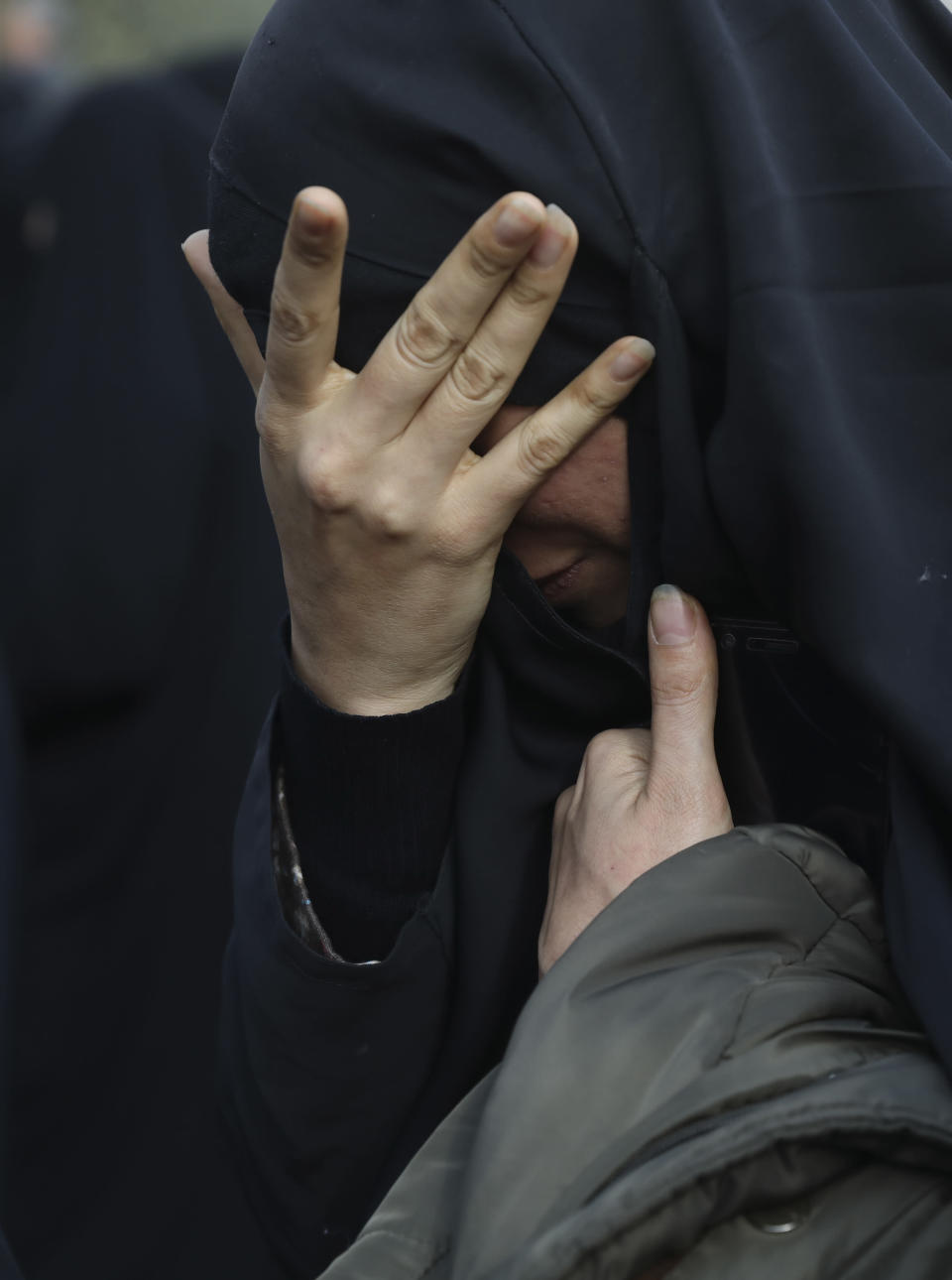 """A woman mourns in a demonstration over the U.S. airstrike in Iraq that killed Iranian Revolutionary Guard Gen. Qassem Soleimani in Tehran, Iran, Jan. 3, 2020. Iran has vowed """"harsh retaliation"""" for the U.S. airstrike near Baghdad's airport that killed Tehran's top general and the architect of its interventions across the Middle East, as tensions soared in the wake of the targeted killing. (AP Photo/Vahid Salemi)"""