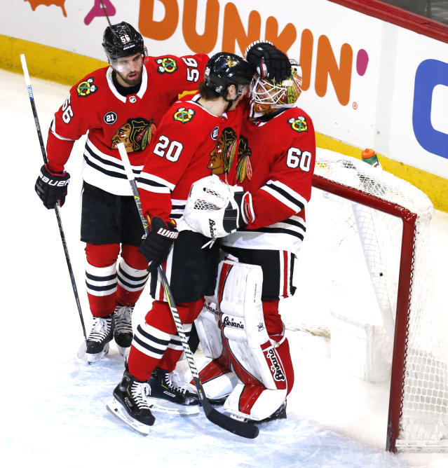 Chicago Blackhawks left wing Brandon Saad (20) celebrates with oaltender Collin Delia g(60) at the end of an NHL hockey game against the Washington Capitals Sunday, Jan. 20, 2019, in Chicago. (AP Photo Nuccio DiNuzzo)
