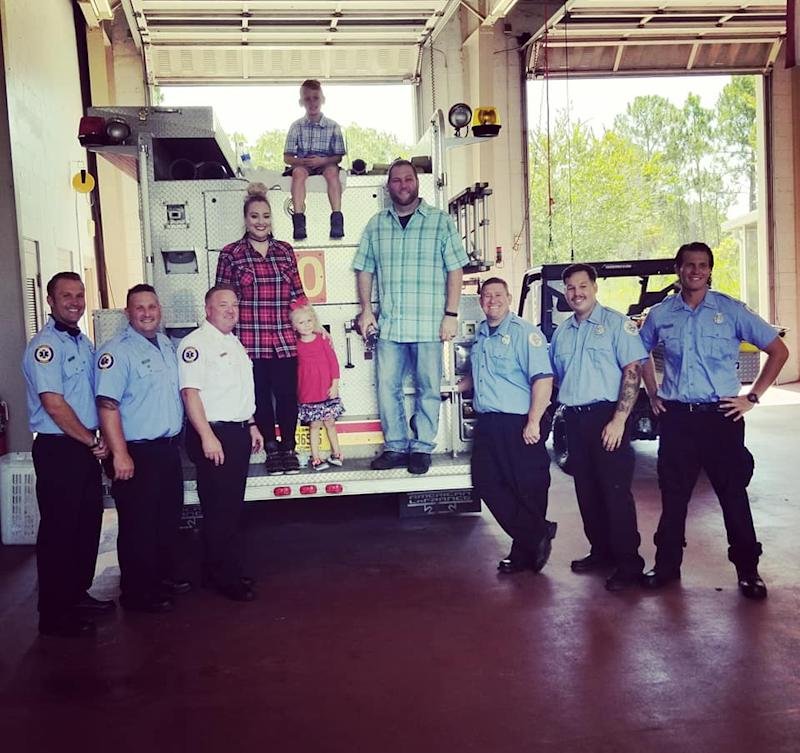 The family with the emergency workers