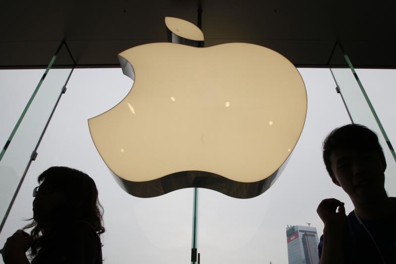 FILE - In this Sept. 24, 2011, file photo, an Apple logo is displayed at the Apple store in International Financial Center (IFC) shopping Mall, in Hong Kong. Under increased pressure from China, Apple has removed a police-tracking smartphone app used by Hong Kong protesters, cut off local access to a news app that extensively covered the anti-government protests and made it harder to find an emoji representing the Taiwanese national flag. (AP Photo/Kin Cheung, File)