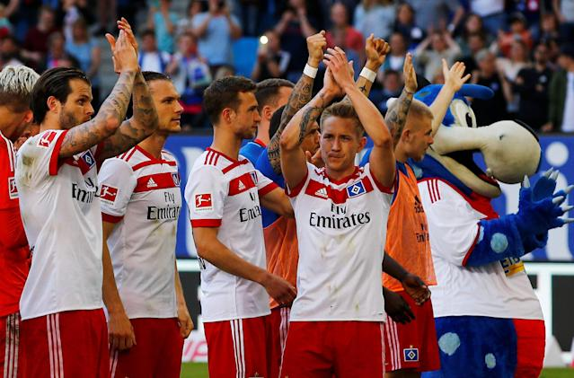 Soccer Football - Bundesliga - Hamburger SV vs SC Freiburg - Volksparkstadion, Hamburg, Germany - April 21, 2018 Hamburg's Lewis Holtby celebrates after the match REUTERS/Morris Mac Matzen DFL RULES TO LIMIT THE ONLINE USAGE DURING MATCH TIME TO 15 PICTURES PER GAME. IMAGE SEQUENCES TO SIMULATE VIDEO IS NOT ALLOWED AT ANY TIME. FOR FURTHER QUERIES PLEASE CONTACT DFL DIRECTLY AT + 49 69 650050