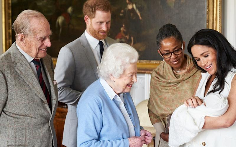 The Duchess of Sussex shows her newborn, Master Archie, to her family - PA