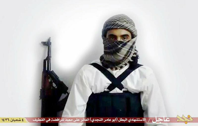FILE - This image from a militant website associated with Islamic State group extremists, posted May 23, 2015, purports to show a suicide bomber identified as a Saudi citizen with the nom de guerre Abu Amer al-Najdi who carried out an attack on a Shiite mosque. A new study published Tuesday, Feb. 5, 2019, by the King Faisal Center for Research and Islamic Studies is challenging the notion that jihadist fighters are necessarily disenfranchised and lacking opportunity, finding instead that most millennial Saudi jihadists were relatively well-educated, not driven purely by religious ideology and showed little interest in suicide bombings. (Militant photo via AP, File)