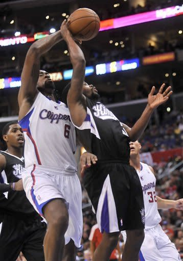 Los Angeles Clippers center DeAndre Jordan, left, blocks a shot from behind as Sacramento Kings guard Aaron Brooks, right, drives to the basket in the first half of an NBA basketball game in Los Angeles on Saturday, Dec. 1, 2012. (AP Photo/Richard Hartog)