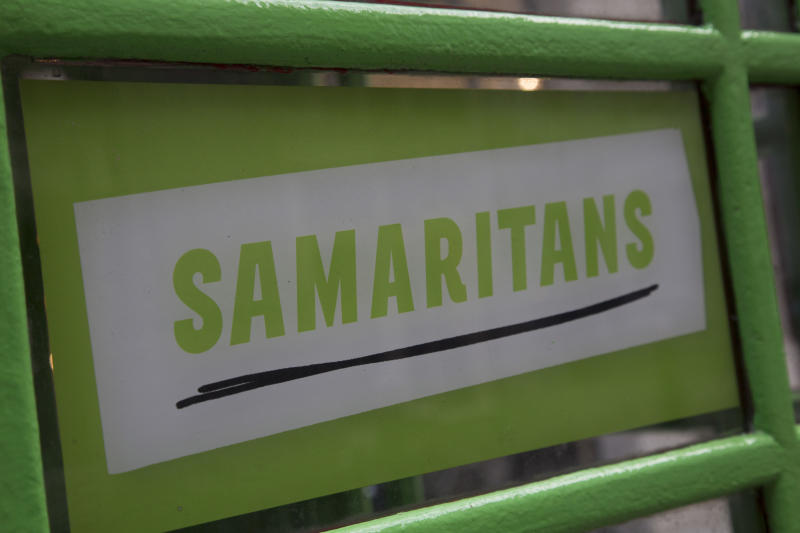 Green Samaritans charity sponsored phone boxes in the City of London, UK. Samaritans is a registered charity aimed at providing emotional support to anyone in distress, struggling to cope, or at risk of suicide throughout the United Kingdom and Ireland, often through their telephone helpline. (Photo by In Pictures Ltd./Corbis via Getty Images)