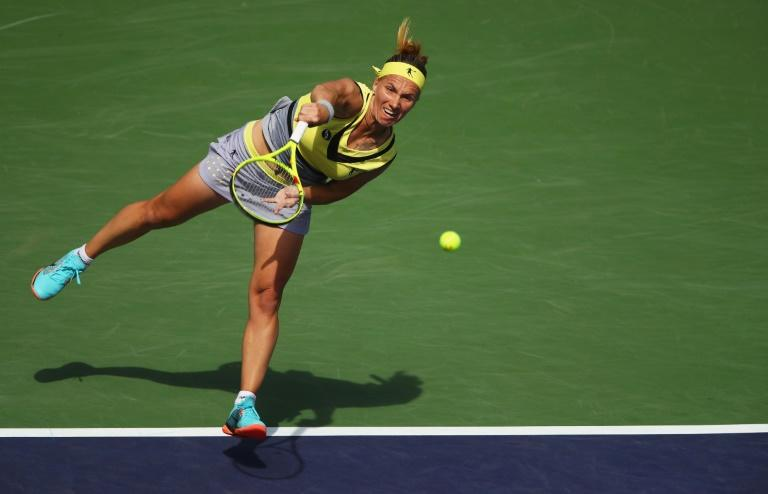 Svetlana Kuznetsova of Russia serves against Anastasia Pavlyuchenkova of Russia in the quarter final match during day ten of the BNP Paribas Open at Indian Wells Tennis Garden on March 15, 2017