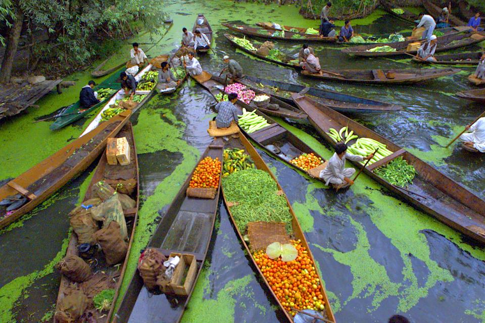 Kashmiri vegetable sellers gather at a floating market on Dal Lake in Srinagar. REUTERS/Kamal Kishore