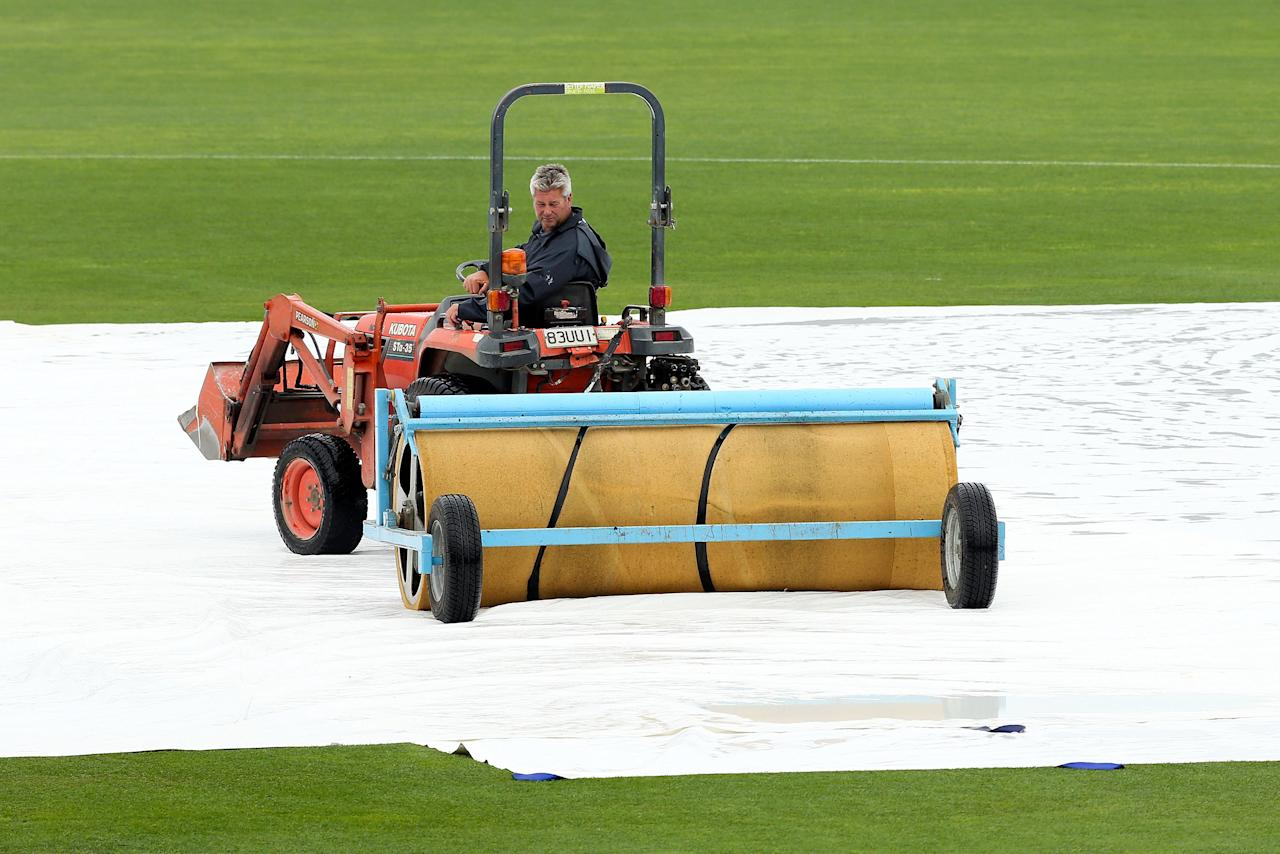 NAPIER, NEW ZEALAND - DECEMBER 29:  A groudsman works to prepare the pitch during game two of the One Day International series between New Zealand and the West Indies at McLean Park on December 29, 2013 in Napier, New Zealand.  (Photo by Hagen Hopkins/Getty Images)