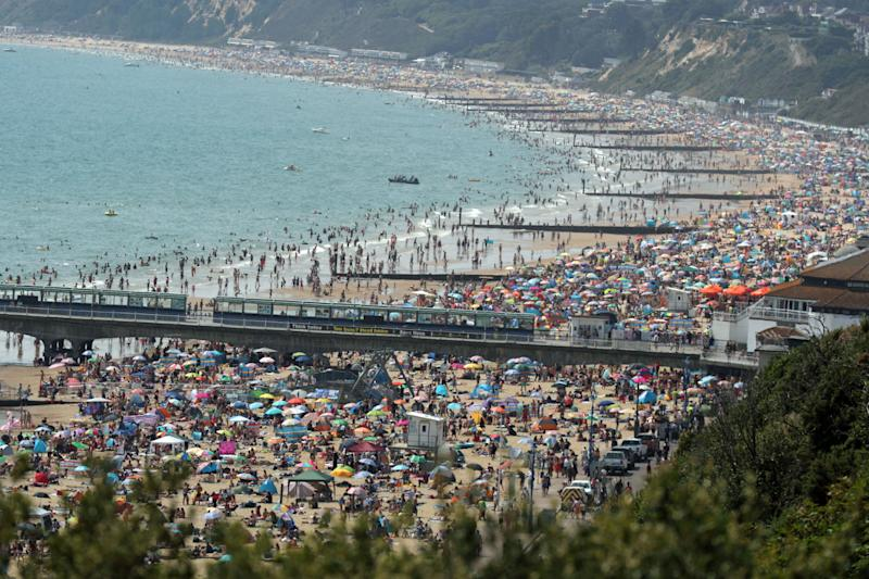 People on Bournemouth beach as the Met Office says it expects Friday to be the hottest day of the year so far with temperatures even nudging into 35C (95F) in Greater London. (Photo by Steve Parsons/PA Images via Getty Images) (Photo: Steve Parsons - PA Images via Getty Images)