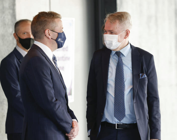 Finnish Foreign Minister Pekka Haavisto, right, is greeted by Icelandic Minister of Foreign Affairs Gudlaugur Thor Thordarson as he arrives for the Arctic Council Ministerial Meeting in Reykjavik, Iceland, Thursday, May 20, 2021. (AP Photo/Brynjar Gunnarsson, Pool)