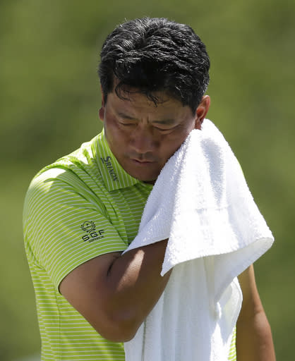 K.J. Choi, of Korea, wipes his face on the fifth tee during the second round of the Memorial golf tournament Friday, May 30, 2014, in Dublin, Ohio. (AP Photo/Darron Cummings)