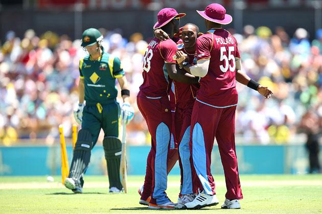 Dwayne Bravo of the West Indies celebrates the wicket of Michael Clarke of Australia with Darren Sammy and Kieron Pollard during game two of the Commonwealth Bank One Day International Series between Australia and the West Indies at WACA on February 3, 2013 in Perth, Australia.  (Photo by Paul Kane/Getty Images)