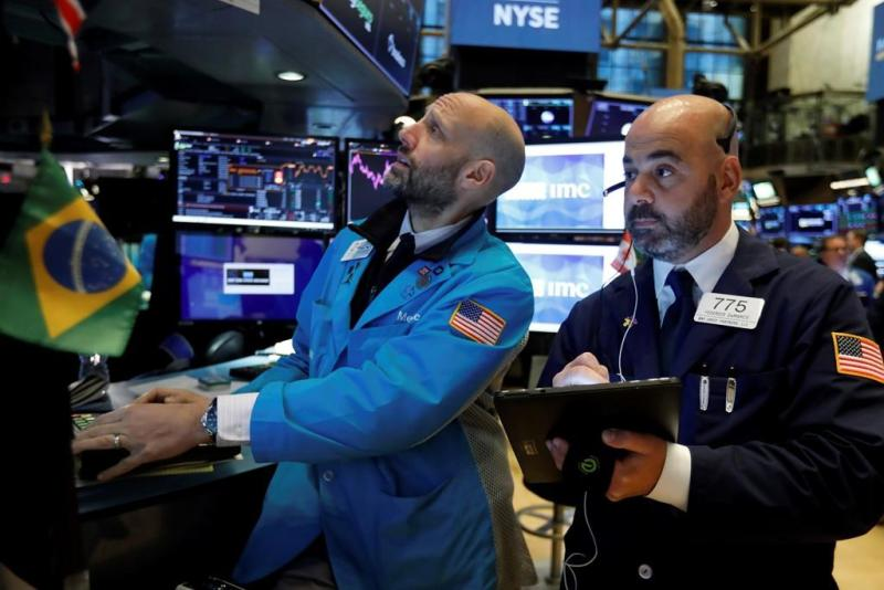 Dow crosses 28,000 for first time as stocks close at record highs