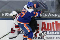 New York Islanders' Matt Martin (17) checks New Jersey Devils' Nico Hischier during the second period of an NHL hockey game Thursday, May 6, 2021, in Uniondale, N.Y. (AP Photo/Frank Franklin II)