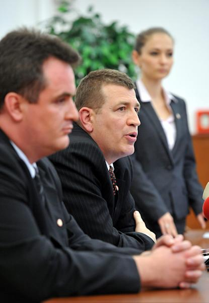 Budapest's acting chief prosecutor Tibor Ibolya, center, speaks to journalists at a news conference concerning the arrest of alleged Nazi war criminal Laszlo Csatary in Budapest, Hungary, Wednesday, July 18, 2012. Hungarian prosecutors said Wednesday they had taken into custody, and charged with war crimes, a man suspected of taking part in the deportation of Jews during the Holocaust. (AP Photo/MTI, Tamas Kovacs)