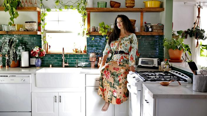 "Designer Justina Blakeney in her Los Angeles kitchen. <span class=""copyright"">(Christina House / Los Angeles Times)</span>"